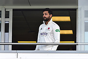 Murali Vijay of Somerset looks out from the team balcony after a heavy rain shower delayed the start of play during the Specsavers County Champ Div 1 match between Somerset County Cricket Club and Essex County Cricket Club at the Cooper Associates County Ground, Taunton, United Kingdom on 26 September 2019.