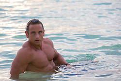 All American muscular man relaxing in the ocean in Bermuda