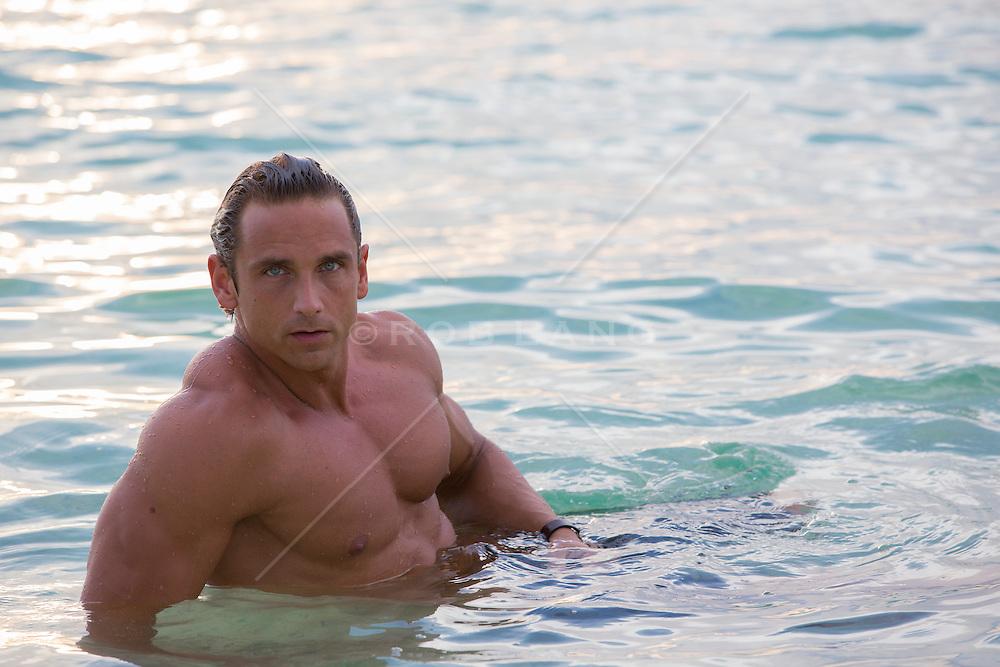 All American muscular man relaxing in the ocean in Bermuda