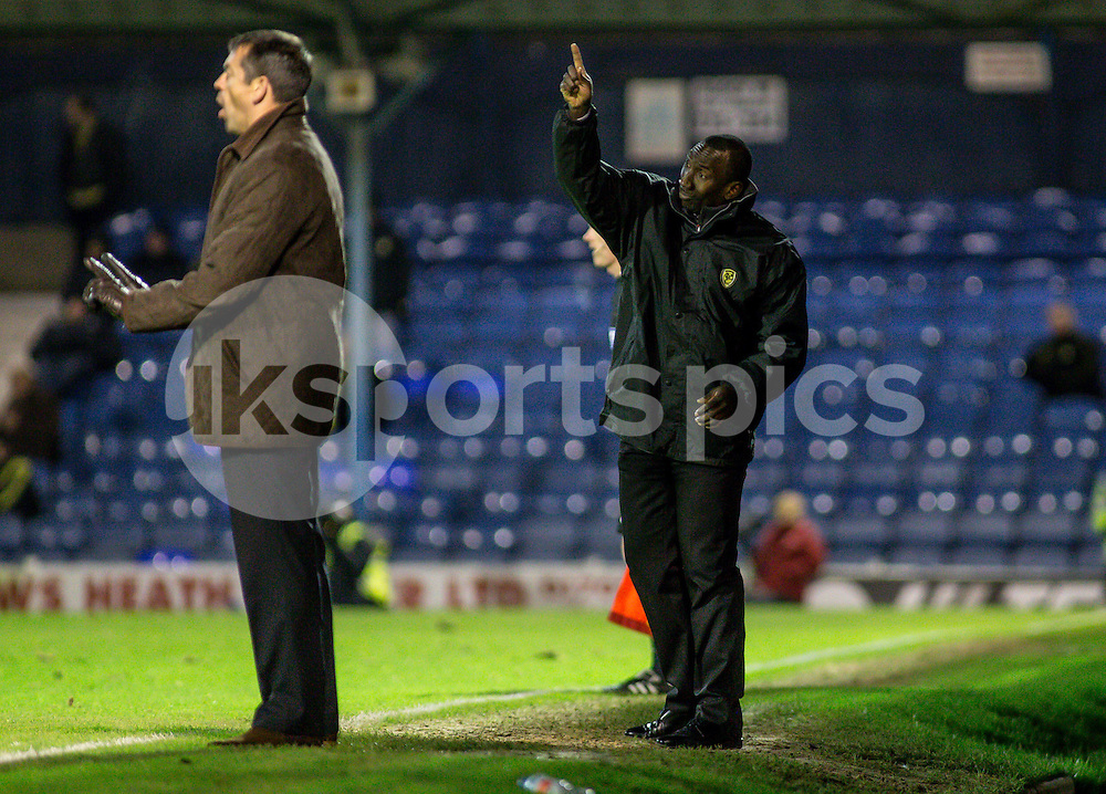 Burton Albion Manager Jimmy Floyd Hasselbaink barks the orders during the Sky Bet League 2 match between Southend United and Burton Albion at Roots Hall, Southend, England on 19 December 2014. Photo by Liam McAvoy.