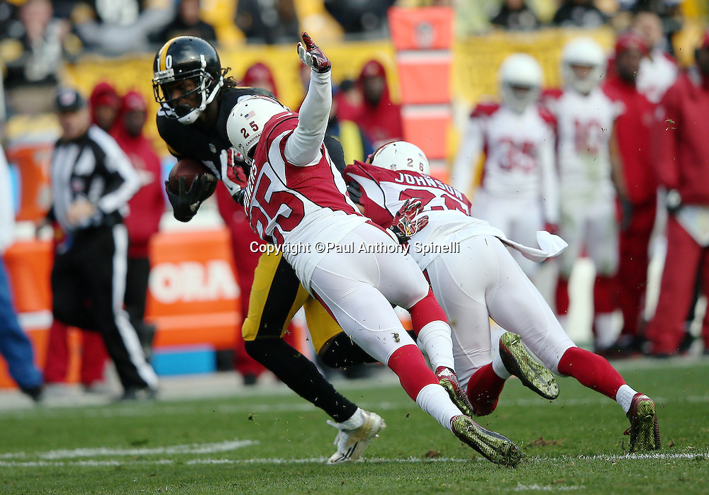 Pittsburgh Steelers wide receiver Martavis Bryant (10) catches a third quarter pass for a first down in Arizona Cardinals territory while being chased by Arizona Cardinals diving cornerback Jerraud Powers (25) and Arizona Cardinals free safety Rashad Johnson (26) during the 2015 NFL week 6 regular season football game against the Arizona Cardinals on Sunday, Oct. 18, 2015 in Pittsburgh. The Steelers won the game 25-13. (©Paul Anthony Spinelli)