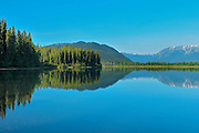 Coast Mountains reflected in Tattoga Lake <br /> near Iskut along the Stewart Cassiar Highway<br /> British Columbia<br /> Canada