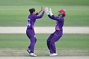 Georgia Elwiss and Amy Jones of Loughborough Lightning celebrate the wicket of Fi Morris during the Kia Women's Cricket Super League semi-final match between Loughborough Lightning and Southern Vipers at the 1st Central County Ground, Hove, United Kingdom on 1 September 2019.