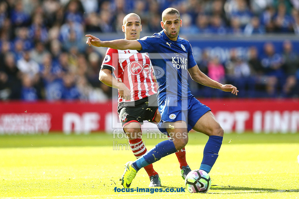 Islam Slimani of Leicester City (right) during the Premier League match at the King Power Stadium, Leicester<br /> Picture by Andy Kearns/Focus Images Ltd 0781 864 4264<br /> 02/10/2016