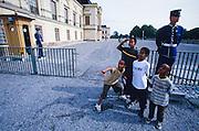 Drottningholm Royal Castle. Kids posing with guards.
