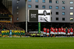 Norwich City and Manchester United players during 1 minutes applause for the late Norwich city defender Duncan Forbes - Mandatory by-line: Phil Chaplin/JMP - 27/10/2019 - FOOTBALL - Carrow Road - Norwich, England - Norwich City v Manchester United - Premier League