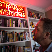 Author George Pelecanos in his home office, in Silver Spring, Maryland.