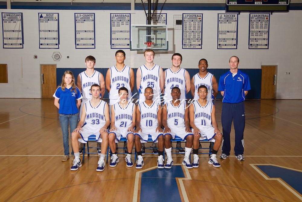 Front row (l to r) Luke Crothamel, Bobby Ford, Rashad Bolden, L.J. Ward, Patrick Roebuck.  Second row (l to r) Manager Rachel Yowell, Travis Warren, Matt Temple, Nick Paxton, Gage Berryman, Terez Terrell, Head Coach Ben Breeden.  December/21/10:  MCHS Varsity Boys Basketball Team Photo 2010-2011