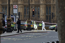 London, March 22nd 2017. A forensics officer at the scene in the aftermath of a shooting incident on Westminster Bridge, where several pedestrians were also mown down by a car.