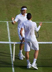 LONDON, ENGLAND - Friday, July 4, 2014: Roger Federer (SUI) and Milos Raonic (CAN) after the Gentlemen's Singles Semi-Final match on day eleven of the Wimbledon Lawn Tennis Championships at the All England Lawn Tennis and Croquet Club. (Pic by David Rawcliffe/Propaganda)