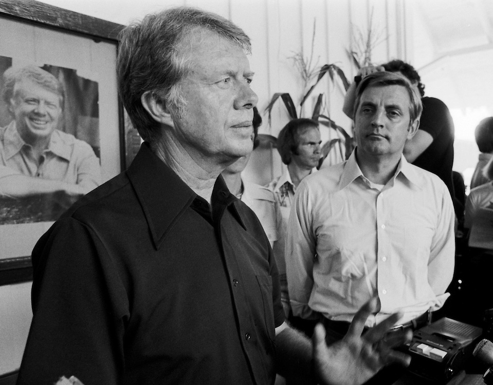"""1976 Democratic presidential nominee Jimmy Carter and his running mate Walter """"Fritz"""" Mondale speak to the press at the Plains, Georgia railway depot. - To license this image, click on the shopping cart below -"""