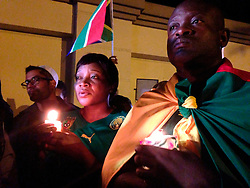 05.12.2013, Johannesburg, ZAF, Nelson Mandela, der Gigant des Humanismus ist im Alter von 95 Jahren in seinem Haus an den Folgen einer Lungenentzuendung gestorben, im Bild People hold candles outside the house of former South African president Nelson Mandela following his death // Nelson Mandela a giant of humanism died in his house in Johannesburg, South Africa on 2013/12/05. EXPA Pictures © 2013, PhotoCredit: EXPA/ Photoshot/ Zhang Chuanshi<br /> <br /> *****ATTENTION - for AUT, SLO, CRO, SRB, BIH, MAZ only*****