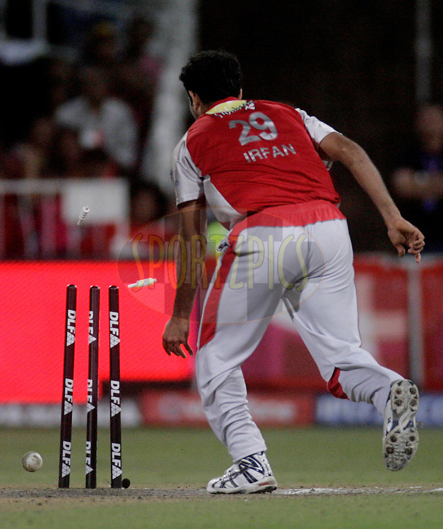 DURBAN, SOUTH AFRICA - 1 May 2009. Irfan Pathan hits the stumps during the IPL Season 2 match between Kings X1 Punjab and the Royal Challengers Bangalore held at Sahara Stadium Kingsmead, Durban, South Africa..
