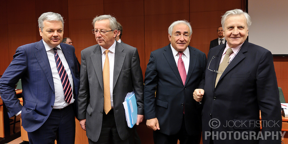 Jean-Claude Juncker, Luxembourg's prime minister, and president of the Eurogroup, center left, speaks with Didier Reynders, Belgium's finance minister, far left, Dominique Strauss-Kahn, managing director of the IMF, center right, and Jean-Claude Trichet, president of the European Central Bank, far right, during the Eurogroup meeting in Brussels, Monday Dec. 6, 2010.  (Photo © Jock Fistick)