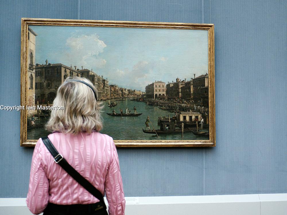 Woman looking at painting at Gemaldegalerie at Kulturforum at Berlin Germany