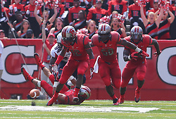 Sep 6, 2014; Piscataway, NJ, USA; Rutgers Scarlet Knights defensive back Nadir Barnwell (12) recovers a blocked kick during the first half at High Points Solutions Stadium.