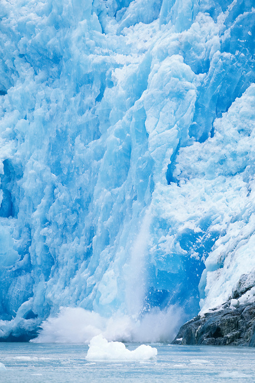 Alaska, Southeast. Sawyer glacier calves icebergs into fjord.