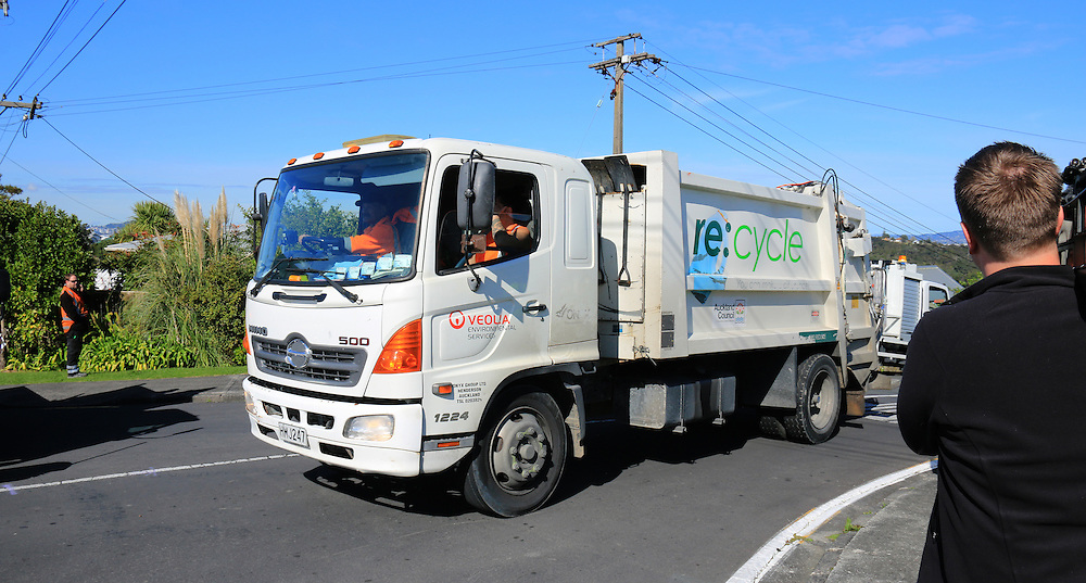 A rubbish truck leaves Hebe Place as police cordon off the road following another rubbish truck rolling killing a worker, Birkenhead, Auckland, New Zealand, Monday, August 10, 2015. Credit:SNPA / Hayden Woodward