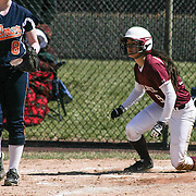 Caravel Academy Outfielder Nicole Marcon (9) slides safely into home in the bottom of the fourth inning of a varsity scheduled game between Caravel Academy and The Delmar Wildcats Saturday, April 4, 2015, at Caravel Athletic Field in Bear Delaware.
