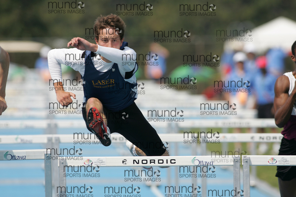 Mike Baran competing in heat three of the senior boys 110m hurdles qualifying round at the 2007 OFSAA track and field championships held in Ottawa.
