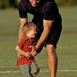 August 6, 2011; Metairie, LA, USA; New Orleans Saints quarterback Drew Brees (9) plays with his son Baylen Brees following training camp practice at the New Orleans Saints practice facility. Mandatory Credit: Derick E. Hingle