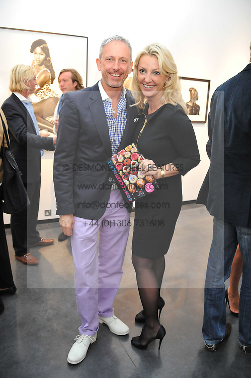 PATRICK COX and BEATRICE WARRENDER at a private view of photographs by Herb Ritts held at Hamiltons Gallery, 13 Carlos Place, London on 21st June 2011.