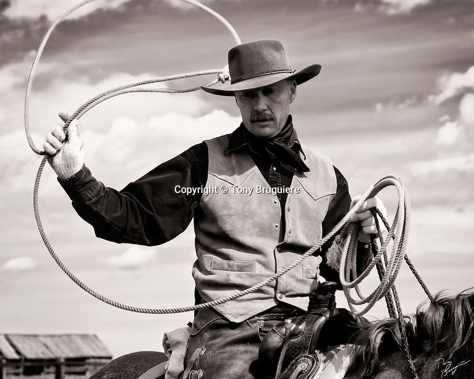This Wyoming cowboy builds his loop as he prepares to rope a calf during a spring branding.