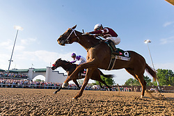 Gun Runner with Florent Geroux up, right, challenged Nyquist with Mario Gutierrez up at the top of the stretch but Nyquist went on to win the 142nd running of the Kentucky Derby, Saturday, May 07, 2016 at Churchill Downs in Louisville.