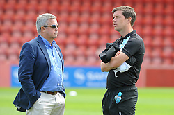 Bristol Rovers chairman, Nick Higgs speaks with Bristol Rovers Manager, Darrell Clarke prior to kick off at Whaddon Road against Cheltenham Town - Mandatory by-line: Dougie Allward/JMP - 25/07/2015 - SPORT - FOOTBALL - Cheltenham Town,England - Whaddon Road - Cheltenham Town v Bristol Rovers - Pre-Season Friendly