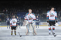 KELOWNA, CANADA, FEBRUARY 8: The Pepsi Save-on Foods Player of the Game lines up with Jordon Cooke #30 and MacKenzie Johnston #22 of the Kelowna Rockets as the Seattle Thunderbirds visit the Kelowna Rockets on February 8, 2012 at Prospera Place in Kelowna, British Columbia, Canada (Photo by Marissa Baecker/www.shootthebreeze.ca) *** Local Caption ***