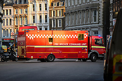 © Licensed to London News Pictures. 29/11/2019. LONDON, UK. A fire brigade command unit arrives as police attend the scene on Southwark Street after the Metropolitan police reported that one man in the area has been shot and the incident is being treated as terror related.  Office workers and local people are currently being evacuated.  Photo credit: Stephen Chung/LNP