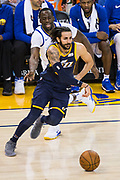 Golden State Warriors forward Draymond Green (23) lets Utah Jazz guard Ricky Rubio (3) slip past him at Oracle Arena in Oakland, Calif., on December 27, 2017. (Stan Olszewski/Special to S.F. Examiner)