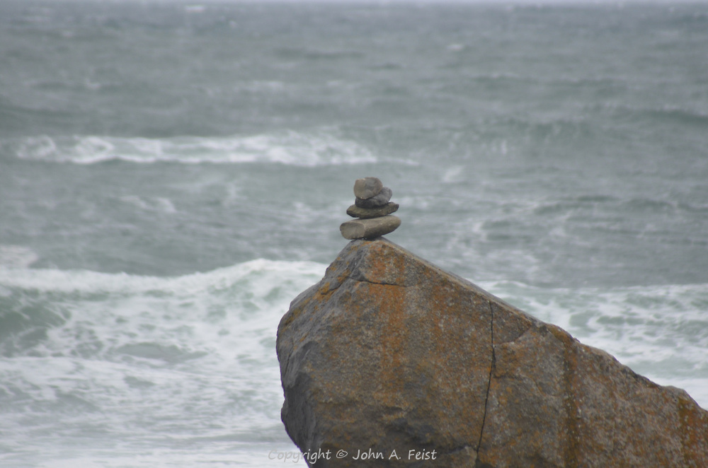 The winds were howling when I took this picture.  This little stack of rocks just stood there.  Doolin, County Clare, Ireland.