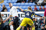 Bolton's Gary Madine  and Oxford's John Lundstram wrestle during the EFL Sky Bet League 1 match between Bolton Wanderers and Oxford United at the Macron Stadium, Bolton, England on 1 October 2016. Photo by Craig Galloway.