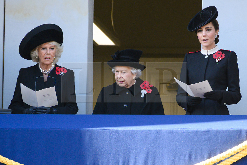 © Licensed to London News Pictures. 11/11/2018. London, UK.  The Duchess of Cornwall, Queen Elizabeth II, The Duchess of Cambridge attend a Remembrance Day Ceremony at the Cenotaph war memorial in London, United Kingdom, on November 11, 2018.  Thousands of people honour the war dead by gathering at the iconic memorial to lay wreaths and observe two minutes silence and marks the 100th anniversary of Armistice Day. Photo credit: Ray Tang/LNP