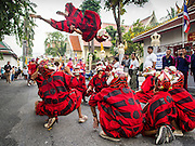 30 OCTOBER 2014 - BANGKOK, THAILAND: A performance troupe that combines dance and acrobatics perform during the parade marking the start of the annual temple fair at Wat Saket. Wat Saket is on a man-made hill in the historic section of Bangkok. The temple has golden spire that is 260 feet high which was the highest point in Bangkok for more than 100 years. The temple construction began in the 1800s in the reign of King Rama III and was completed in the reign of King Rama IV. The annual temple fair is held on the 12th lunar month, for nine days around the November full moon. During the fair a red cloth (reminiscent of a monk's robe) is placed around the Golden Mount while the temple grounds hosts Thai traditional theatre, food stalls and traditional shows.   PHOTO BY JACK KURTZ