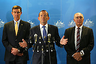 PERTH, AUSTRALIA - MARCH 31:  Australian Prime Minister Tony Abbott addresses the media together with former Defence Force Chief Angus Houston (L) and Deputy Prime Minister Warren Truss (R) at RAAF base Pearce on March 31, 2014 in Perth, Australia. The search continues off the Western Australian coast for Malaysia Airlines flight MH370 that vanished on March 8 with 239 passengers and crew on board. The flight is suspected to have crashed into the southern Indian Ocean with no survivors.  (Photo by Paul Kane/Getty Images) *** Local Caption *** Tony Abbott; Angus Houston; Warren Truss