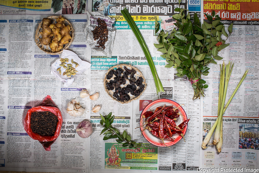 Ingredients for black pork curry : top row from left  - ginger, cloves, rampe (pandan), curry leaves. middle row - cardamon pods, goraka; bottom - black pepper, garlic, dried chili, lemon grass.