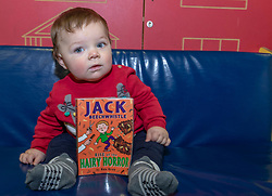 The most popular baby names in Scotland have been announced at Leith Library in Edinburgh. The most names for 2018 are unchanged from 2017 with Jack and Olivia taking the top spots.<br /> <br /> Pictured: 8 month old Gregor Mann holding a book titled with the most popular boys name, Jack