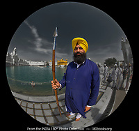 Portrait of a guard at the Sri Harmandir Sahib, also known as the Golden Temple in the city of Amritsar, Punjab, India.