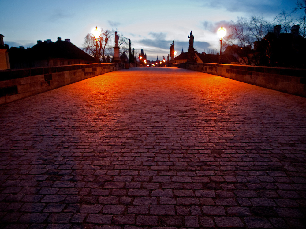 7:20 Early morning at Pragues Charles Bridge. Charles Bridge is one of the oldest and certainly one of the most beautiful stonebridges in Europe, this ancient artery across the Vltava river links Pragues Lesser Town with the Old Town on the right bank.