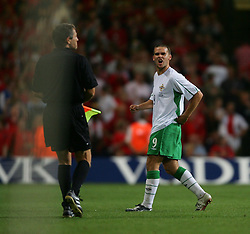 CARDIFF, WALES - Wednesday, September 8, 2004: Northern Ireland's David Healy walks off the pitch after being sent off  during the Group Six World Cup Qualifier against Wales at the Millennium Stadium. (Pic by David Rawcliffe/Propaganda)