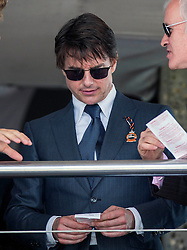 Tom Cruise enjoys a day at the races at Glorious Goodwood, but has no luck with his bet. Image ©Licensed to i-Images Picture Agency. 31/07/2014. Chichester, United Kingdom. Glorious Goodwood. Goodwood Racecourse. Picture by i-Images