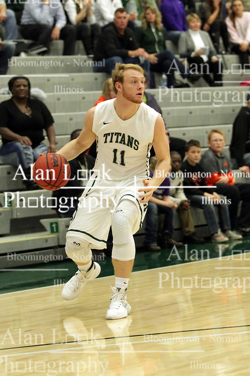 17 November 2015:  Colin Bonnett(11) handles the ball outside the 3 point arc during an NCAA men's division 3 CCIW basketball game between the Greenville College Panthers and the Illinois Wesleyan Titans in Shirk Center, Bloomington IL