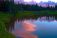 Sunset and reflections in a small lake in the Snowy Range of the Medicine Bow Mountains, Wyoming