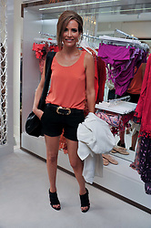 SOPHIE ANDERTON at the opening of the new Melissa Odabash store in Walton Street, London SW3 on 7th July 2011.