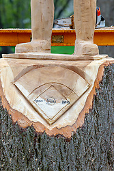 Old Hoss Radbourn chainsaw carving from an old oak tree in Evergreen Cemetery in Bloomington Illinois.  The carving is near the grave of the same.  Old Hoss was a major league baseball player for the Boston Red Sox.  He was born in New York, but raised in Bloomington Il and called it home.  The carving was created by chainsaw artist Bill Baker of Top Notch Chainsaw Carvings of Naperville IL.