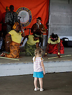 Hamptonburgh, New York - A young girl watches a performance by the Sankofa Drum and Dance Ensemble at the fourth annual Earth & Water Festival at Thomas Bull Memorial Park on June 4, 2011.