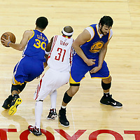 25 May 2015: Golden State Warriors guard Stephen Curry (30) drives past Houston Rockets guard Corey Brewer (33) on a screen set by Golden State Warriors center Andrew Bogut (12) during the Houston Rockets 128-115 victory over the Golden State Warriors, in game 4 of the Western Conference finals, at the Toyota Center, Houston, Texas, USA.