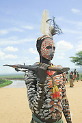 Africa, Ethiopia, Omo Valley, Konso tribe man in front of his thatch roof hut